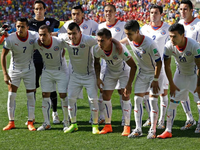 Chile team pose ahead of a match in the FIFA World Cup