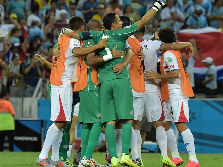 Costa Rica celebrate a win during the FIFA World Cup