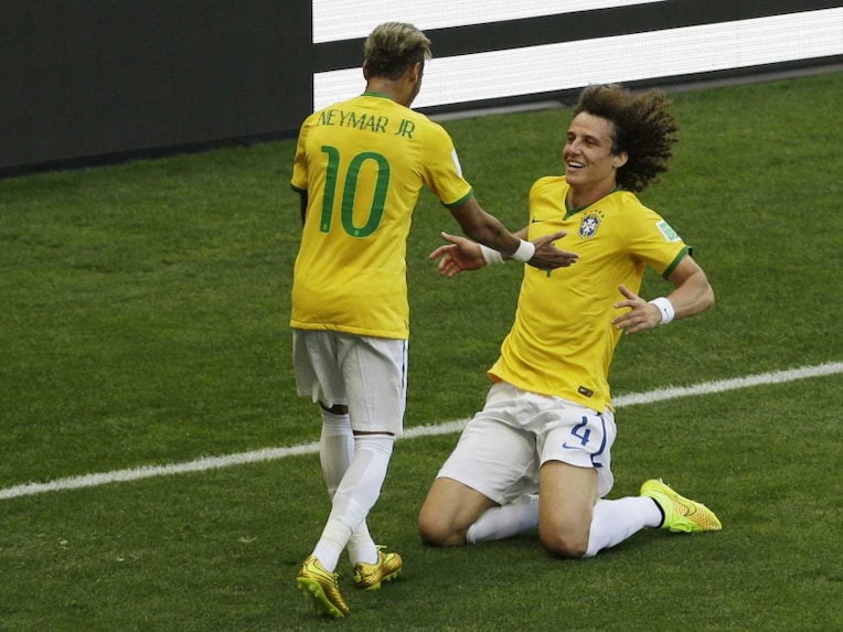 David Luiz, right, celebrates with his teammate Neymar after Brazil scored the opening goal during the FIFA World Cup round of 16 against Chile.