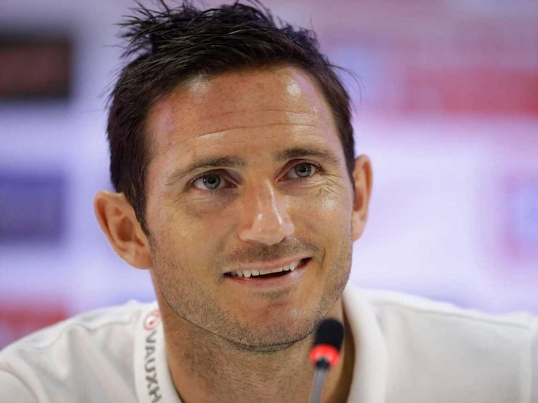 Frank Lampard answers a question from a journalist during a press conference after a squad training session that was closed to the media for the 2014 soccer World Cup at the Urca military base in Rio de Janeiro, Brazil, Tuesday, June 17, 2014.