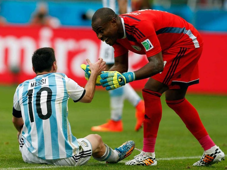 Lionel Messi and Vincent Enyeam