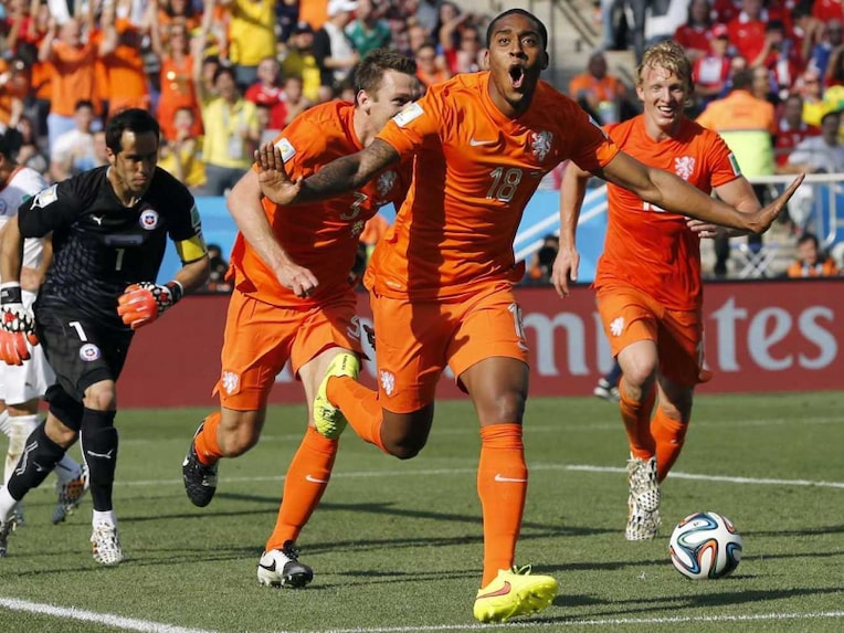 Netherlands celebrate after scoring against Chile in FIFA World Cup