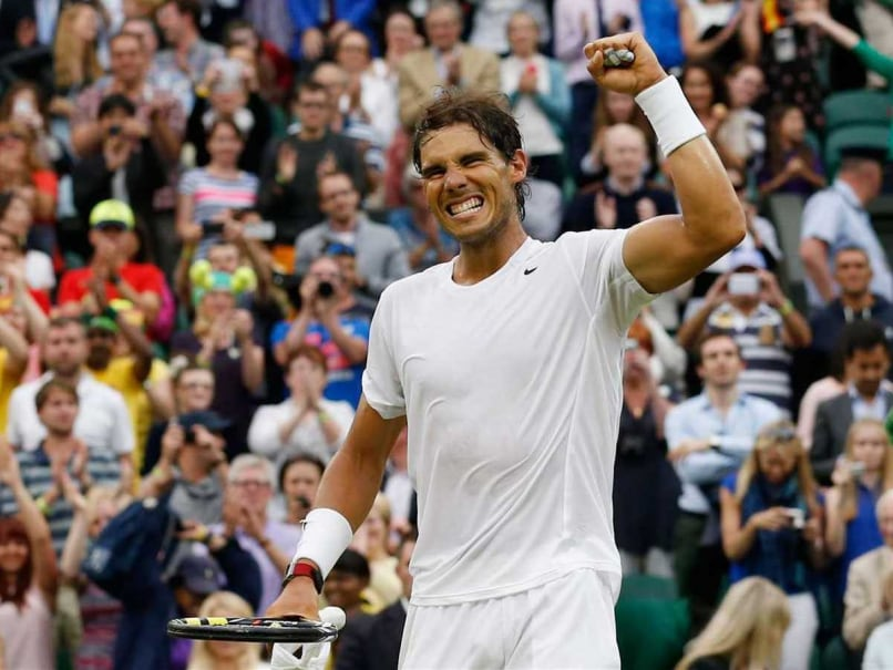 Rafael Nadal celebrates after advancing to 4th round in Wimbledon 2014