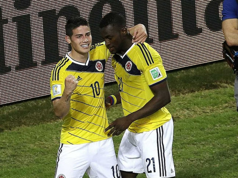 Colombia forward Jackson Martinez, right, celebrates his goal with midfielder James Rodriguez against Japan in the FIFA World Cup 2014.