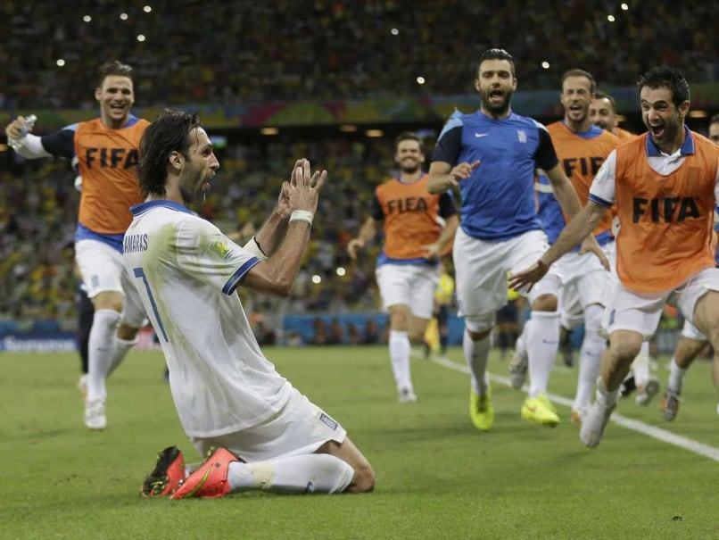 Greeces Giorgos Samaras celebrates scoring his sides 2nd goal from the penalty spot during the FIFA World Cup match against Ivory Coast.