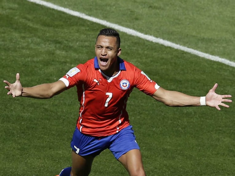 Alexis Sanchez celebrates scoring his side's first goal during the FIFA World Cup Round of 16 match against Brazil.