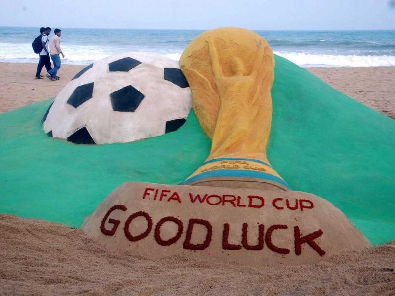 Sand artist Sudarsan Pattnaik creates a sculpture on FIFA World Cup at Puri beach in Odisha.