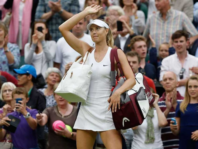 Sharapova waves at fans after winning her 3rd round tie in the Wimbledon