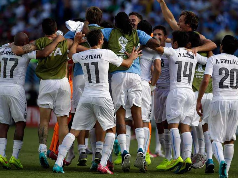Uruguayan players celebrate their 1-0 victory over Italy.