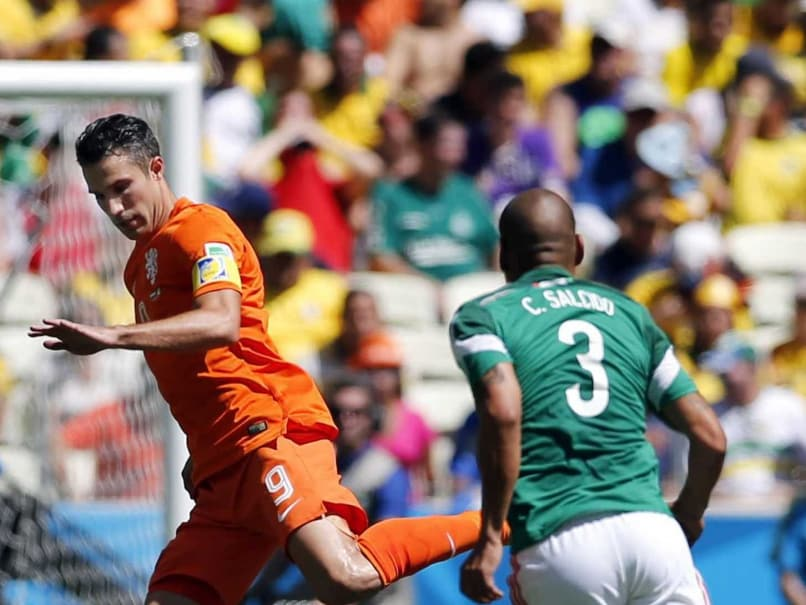 Robin van Persie in action against Mexico in the Round of 16 of the FIFA World Cup 2014.