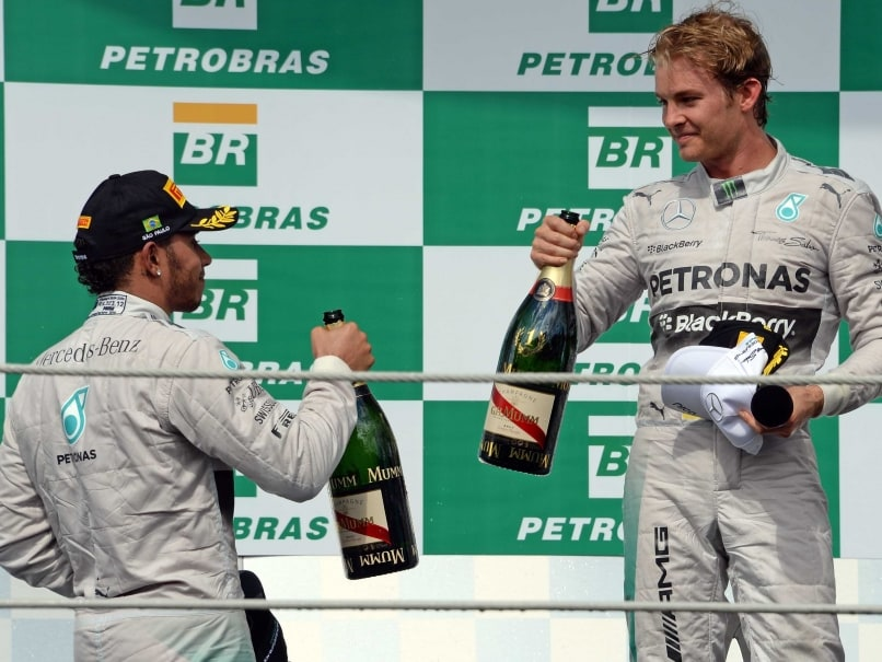 Lewis Hamilton Nico Rosberg champaign