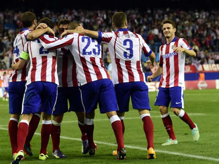 Atletico Madrid team celebrate during Champions League.
