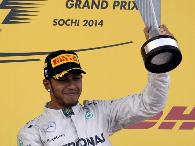 Lewis Hamilton celebrates after winning Russian Grand Prix.