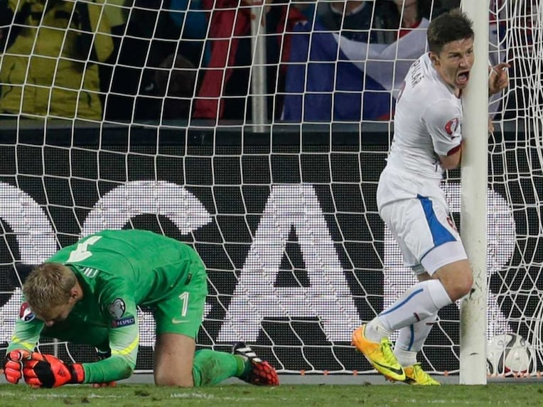 Czech Republic's Vaclav Pilar, right, celebrates scoring past Jasper Cillessen, left, of the Netherlands during the Euro 2016 qualifying match.