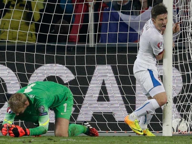 Czech Republic's Vaclav Pilar, right, celebrates scoring past Jasper Cillessen, left, of the Netherlands during the Euro 2016 qualifying match.
