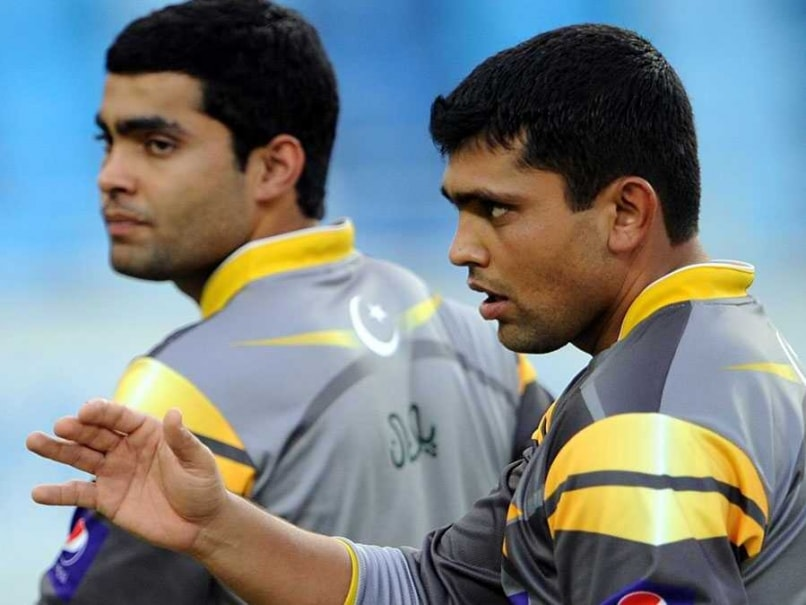 File photo  Umar Akmal  left  and brother Kamran Akmal in practice Umar Akmal And Kamran Akmal Are Brothers