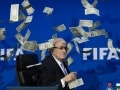 Sepp Blatter Showered With Fake Currency Notes by British Comedian