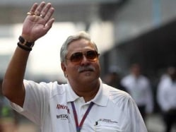 Vijay Mallya Says Life Must go on, in Public Appearance at British GP