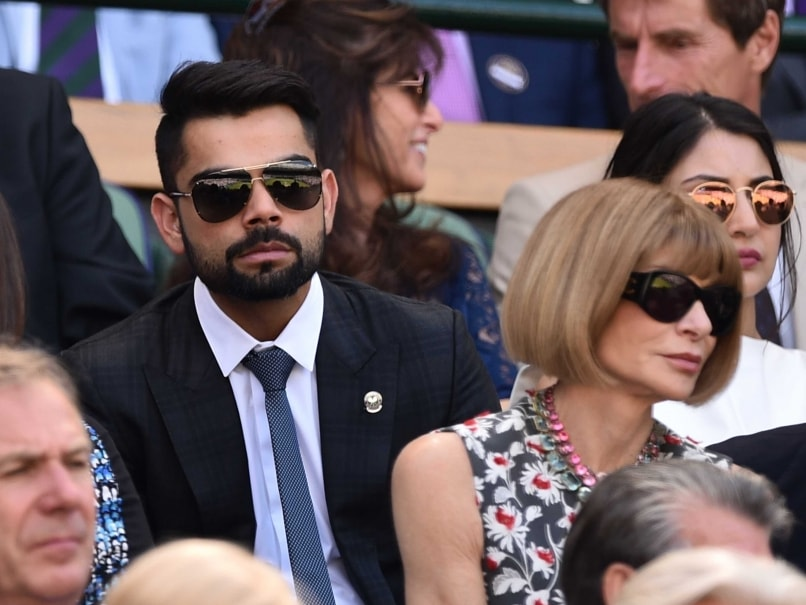 Indian batsman Virat Kohli and his Bollywood star girlfriend at the Centre Court in Wimbledon in london
