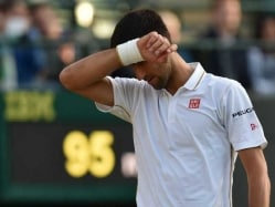 Djokovic Faces Wimbledon Humiliation, Federer Romps Into Rd 4