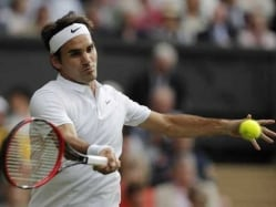 Wimbledon: Roger Federer, Garbine Muguruza Advance to Second Round