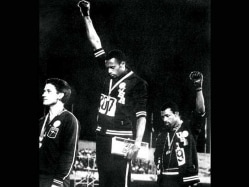 Raised-Fist Olympians Punished in 1968 Will be Received at White House