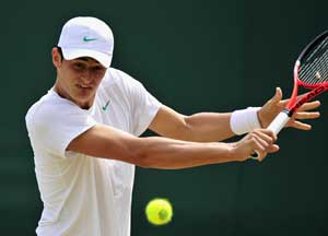In this file photo, Bernard Tomic is seen returning the ball.