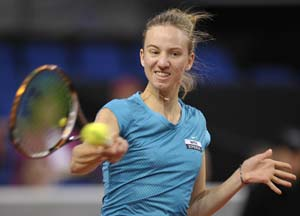 In this file photo, Mona Barthel is seen returning a shot.