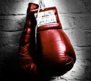 In this representational pic, a pair of boxing gloves are shown hanging down