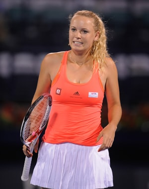 Wozniacki, Tomic advance at Eastbourne