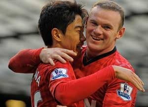 In this file photo, Shinji Kagawa and Wayne Rooney celebrate a goal for Manchester United.
