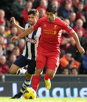 In this file photo, Luis Suarez is seen playing for Liverpool.