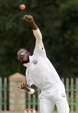 Nikita Miller on his way to a 5-wicket haul vs India A