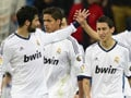 Real Madrid hit Malaga for six, delay Barca title party