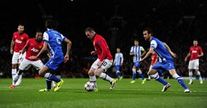 Wayne Rooney (with the ball)