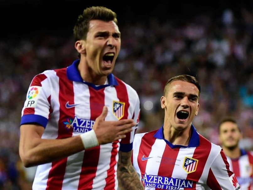 La Liga Champions Atletico Madrid Struggle Past Eibar for First Win