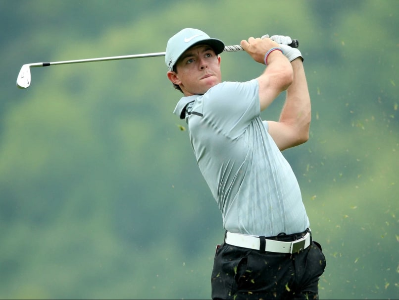Rory McIlroy Leads But Rivals Make Charge at Rainy PGA Championship, Tiger Woods Misses Cut