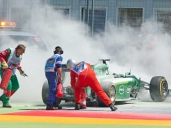 German GP: Kamui Kobayashi Leaps to Safety From Burning Caterham
