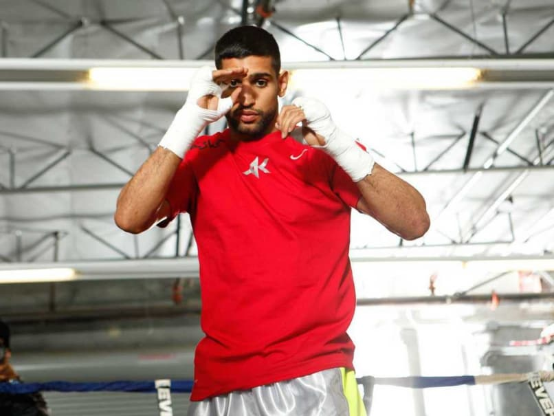 Boxer Amir Khan of Britain Arrested in Assaults Probe