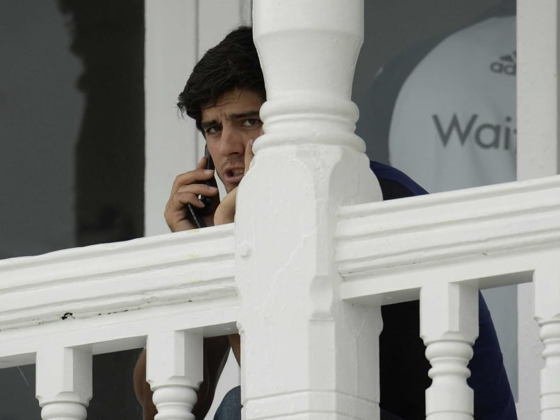 Englands captain Alastair Cook talks on a phone while waiting for a training session before the Test Against India at Trent Bridge.