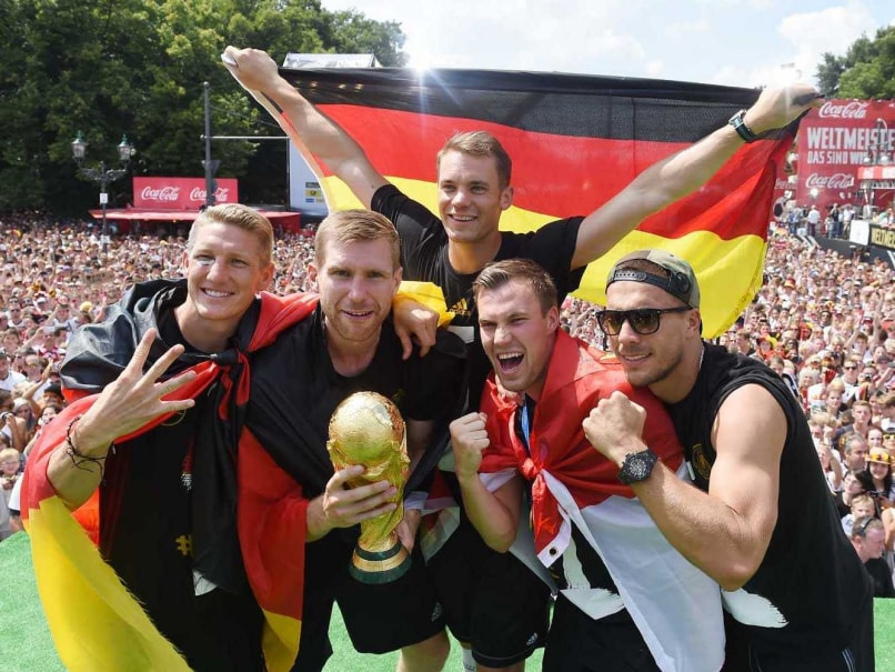 FIFA World Cup: Germans Celebrate With Trophy, England Party with Cigars and Bikinis