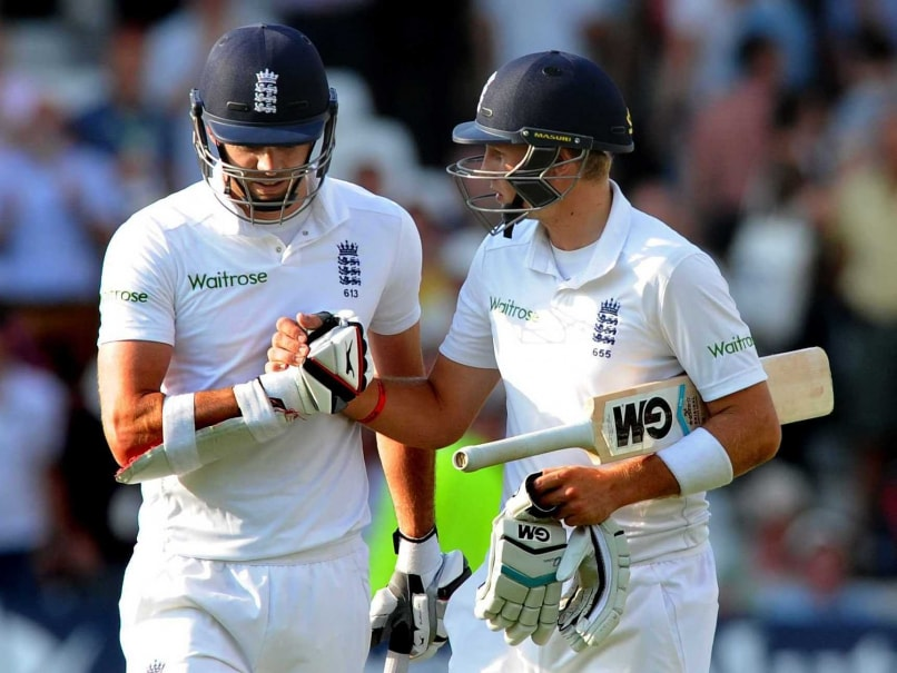 England's James Anderson, left, shakes hands with Joe Root at end of play finishing 23 and 78 not out respectively during day three of the first Test between England and India at Trent Bridge cricket ground, Nottingham, England, Friday, July 11, 2014.