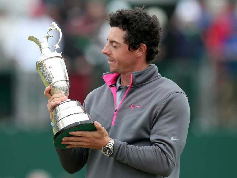 Rory McIlroy admires his British Open Trophy.