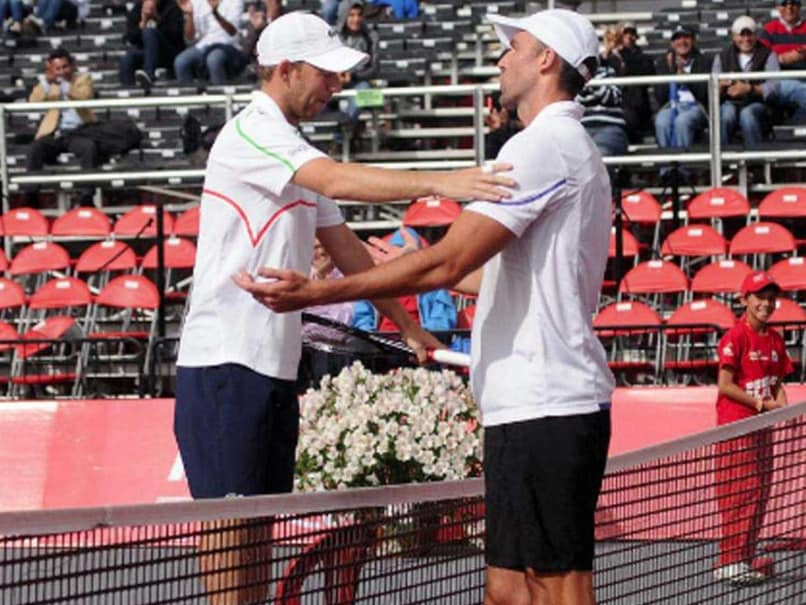 When Tennis' Big Guys Become 'Too Big' for Just a Handshake