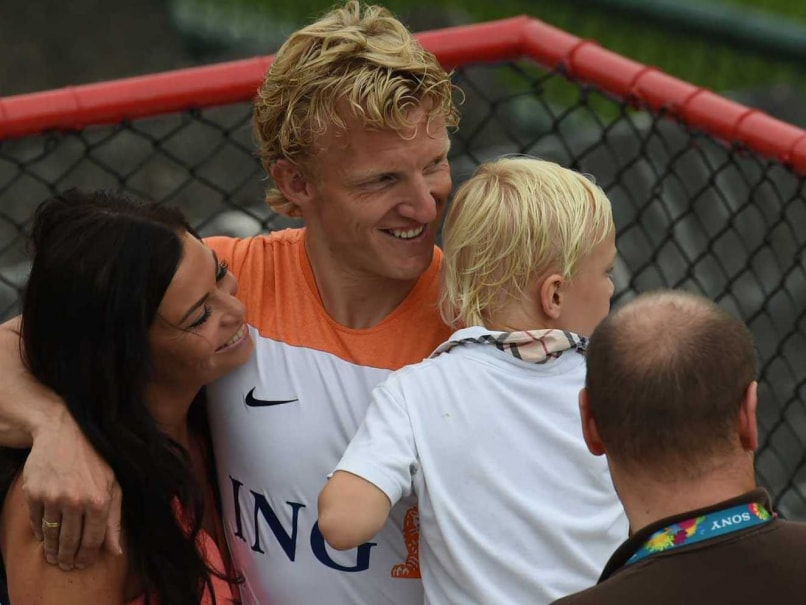 Netherland's Dirk Kuyt (C) with his wife Gertrude and son during a team training session at The Flamenco Football Stadium.