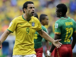 Brazil Striker Fred Attacked With Beer Cans by Fans