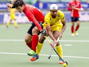 India and South Korea in action during the ninth place playoff match in hockey World Cup