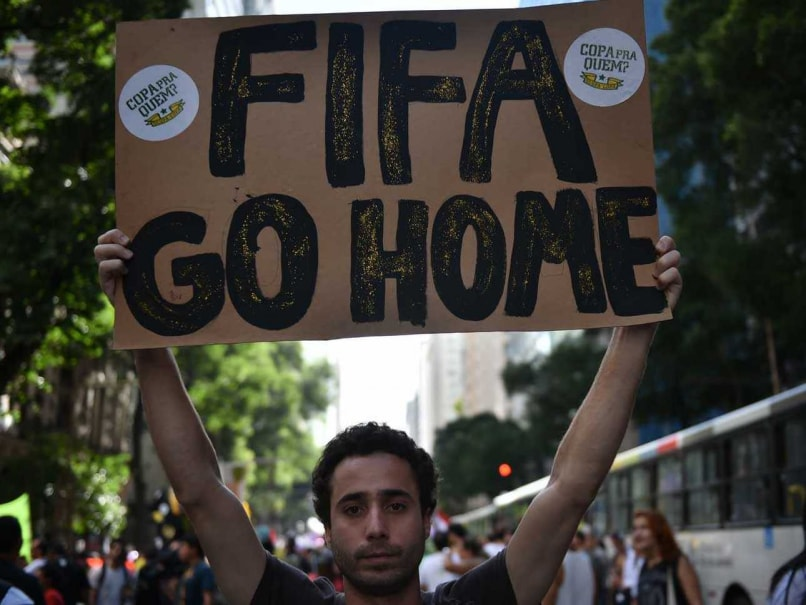 FIFA World Cup: Rio Officer Shoots Live Round During Protests