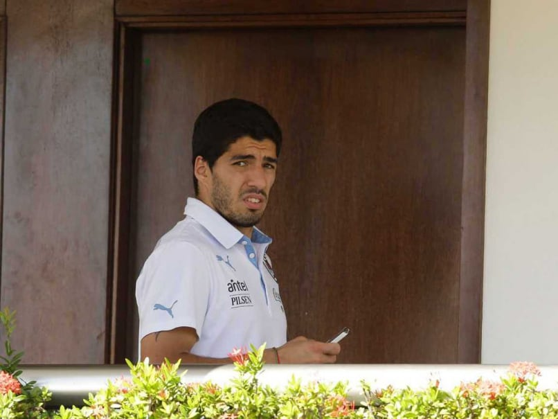 Luis Suarez has retured to Uruguay after being banned from the FIFA World Cup for allegedly biting an opponent in the game vs Italy