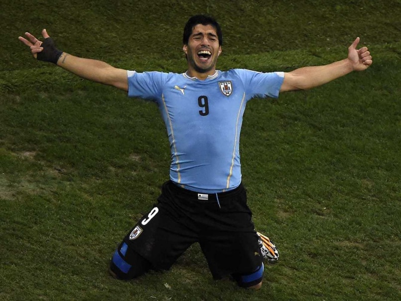 Uruguay's Suarez Staggers England With Finesse, Then Ferocity